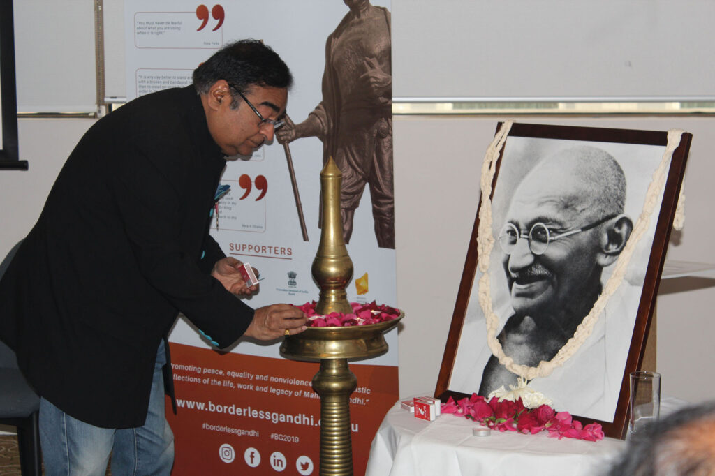 Borderless Gandhi 2019 Dr Mukesh Batra lighting the diya